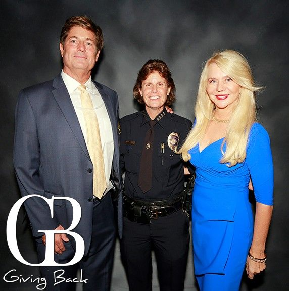 Don_Vaughn__Chief_Shelley_Zimmerman_and_Kathryn_Vaughn-6046-1000-800-80-wm-left_bottom-100-GivingBackWatermark2017png